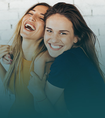 two female friends, smiling