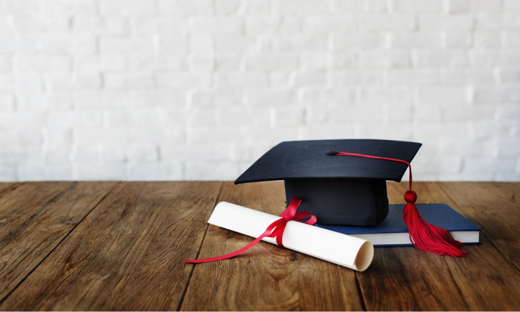 dental school graduate's hat and diploma