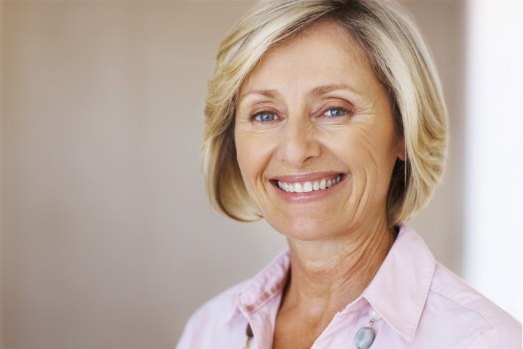 blond woman smiling considering botox injections to remove wrinkles
