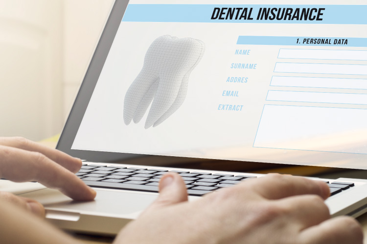 Photo of a computer screen with dental insurance signup information
