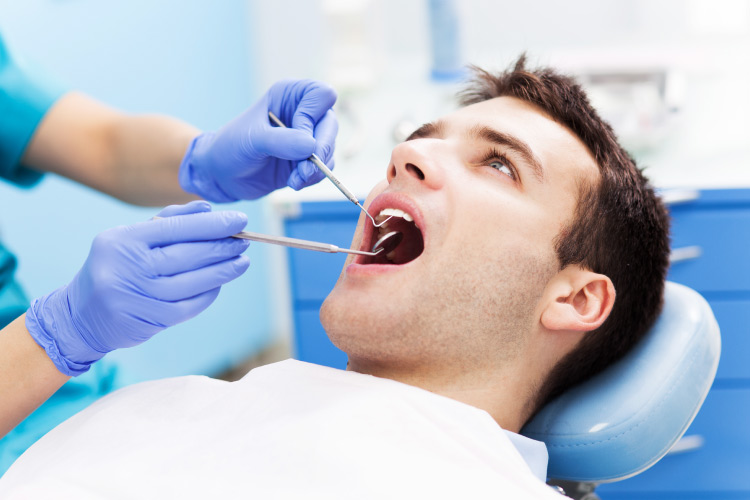Young man in a dental chair getting preventive care