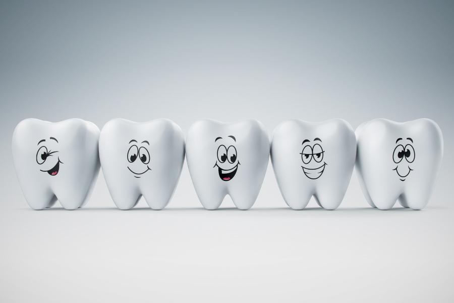 A row of five cartoon smiling teeth